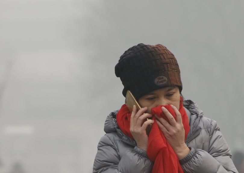 Person shielding nose against pollution