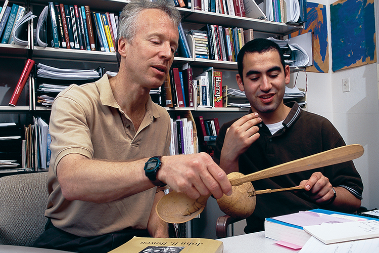Anthropology professor John Bowen in office working with student