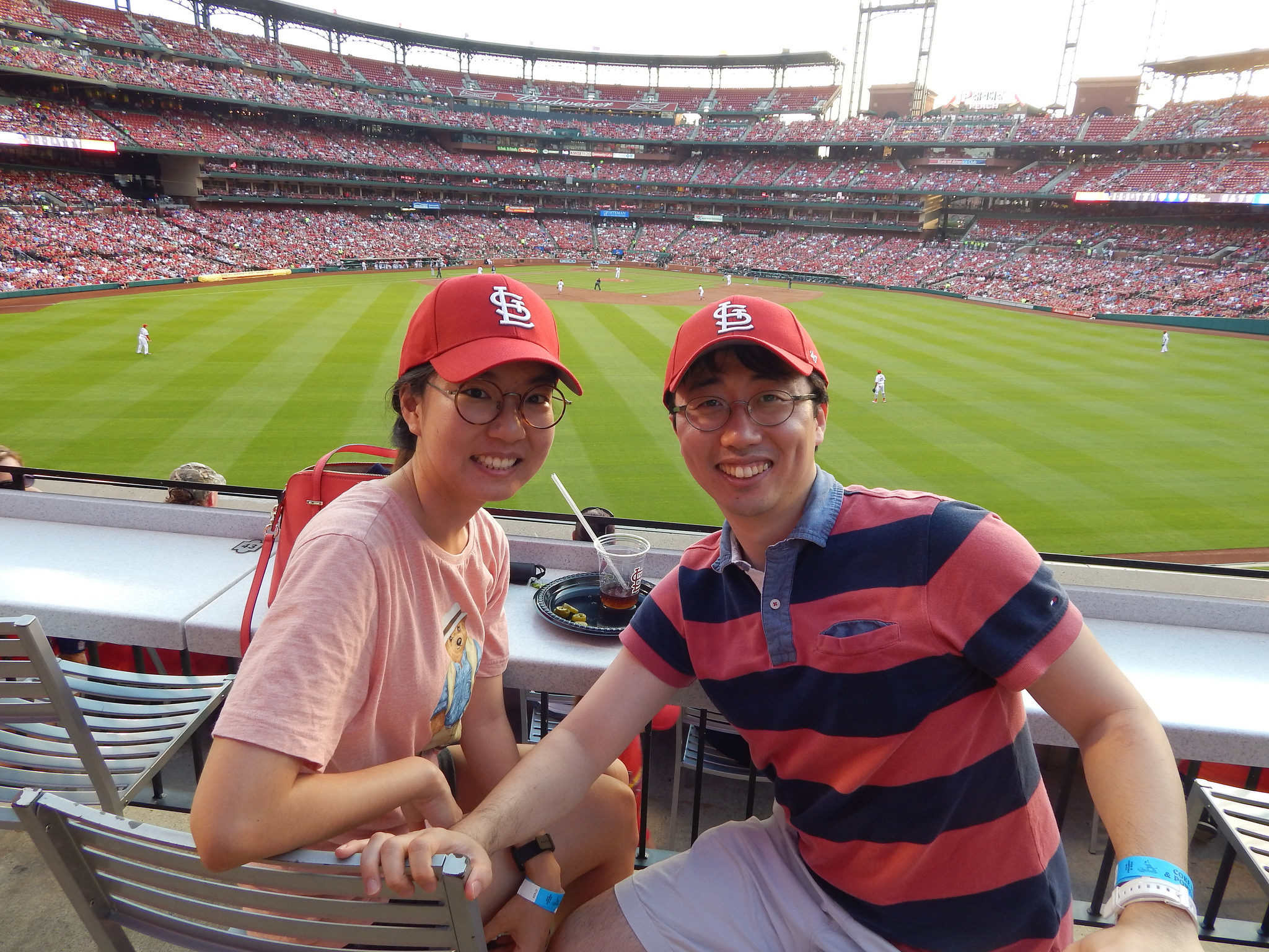 McDonnell Scholars and spouse during Cardinal game.