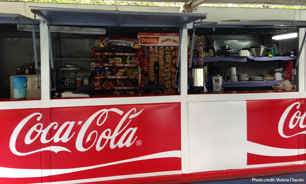 A public school kiosk is sponsored by Coca-Cola, a beverage industry targeting Guatemalan youth.