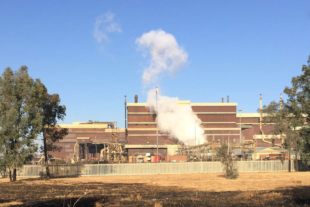 A manganese smelting plant in South Africa belches out white smoke.