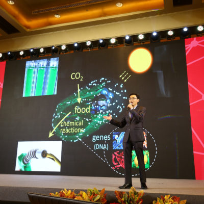 Po-Cheng Lin presenting on stage