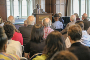 Benjamin Akande, director of the Africa initiative at Washington University in St. Louis, discusses the Initiative's progress at its inaugural meeting April 23.